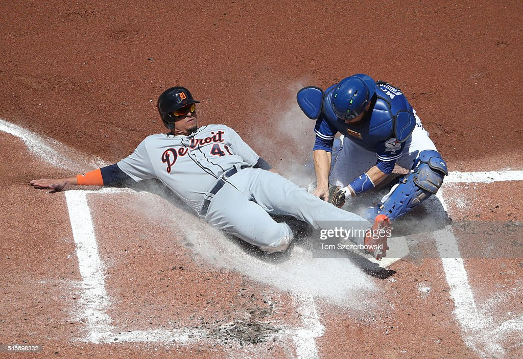 Victor Martinez #41 of the Detroit Tigers is thrown out at home plate in the second inning during MLB game action as Russell Martin #55 of the Toronto Blue Jays tags him out on July 9, 2016 at Rogers Centre in Toronto, Ontario, Canada.