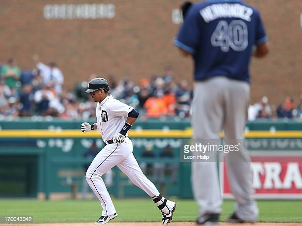 Victor Martinez of the Detroit Tigers rounds second base after hitting a tworun home run to right field scoring teammate Prince Fielder in the fourth...