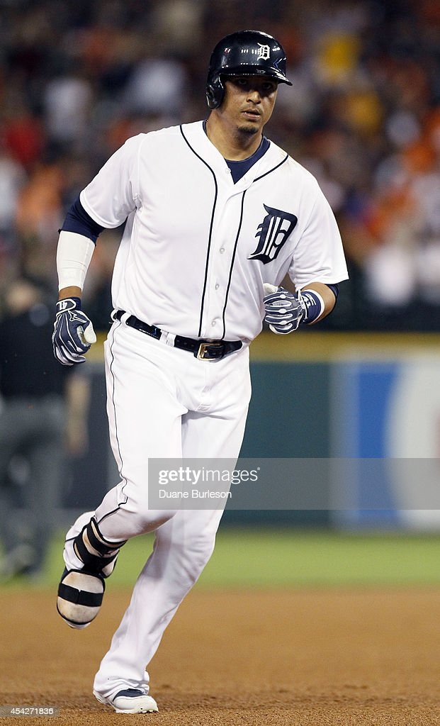 Victor Martinez #41 of the Detroit Tigers rounds the bases after hitting a solo home run against the New York Yankees during the sixth inning at Comerica Park on August 27, 2014 in Detroit, Michigan.