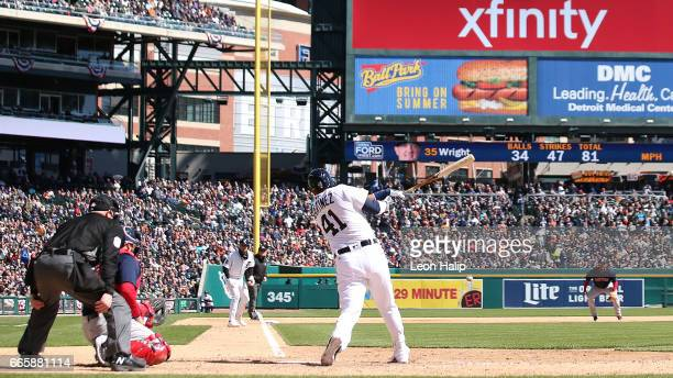 Victor Martinez of the Detroit Tigers singles to left field scoring Nicholas Castellanos during the sixth inning of the opening day game against the...
