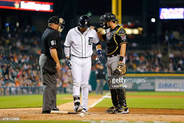 Victor Martinez of the Detroit Tigers stands at the plate after being hit by a pitch as catcher Francisco Cervelli of the Pittsburgh Pirates looks on...