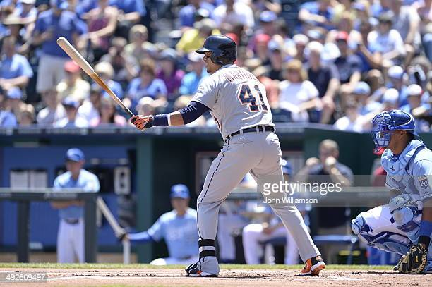 Victor Martinez of the Detroit Tigers stands in the batter's box with his bat extended toward the pitcher as he prepares to bat against the Kansas...