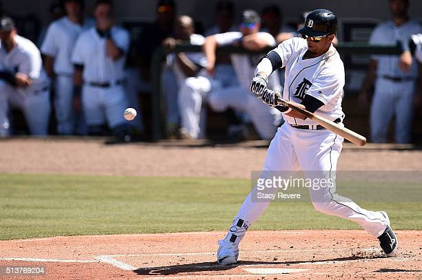 Victor Martinez of the Detroit Tigers swings at a pitch during the first inning of a spring training game against the New York Yankees at Joker...