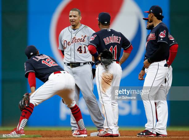 Victor Martinez of the Detroit Tigers talks with Francisco Lindor Jose Ramirez Erik Gonzalez and Carlos Santana of the Cleveland Indians during...