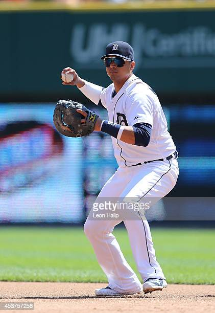 Victor Martinez of the Detroit Tigers throws the ball to the pitcher covering the bag during the sixth inning of the game against the Seattle...
