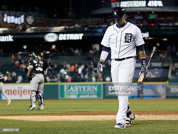 Victor Martinez of the Detroit Tigers walks off the field after striking out as Rob Brantly of the Chicago White Sox and pitcher David Robertson of...