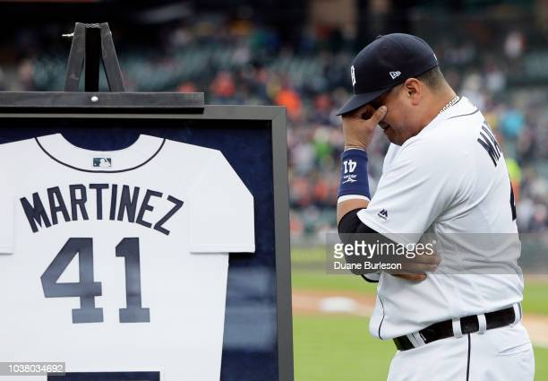 Victor Martinez of the Detroit Tigers wipes away tears during his retirement ceremony before the game against the Kansas City Royals, the final game...