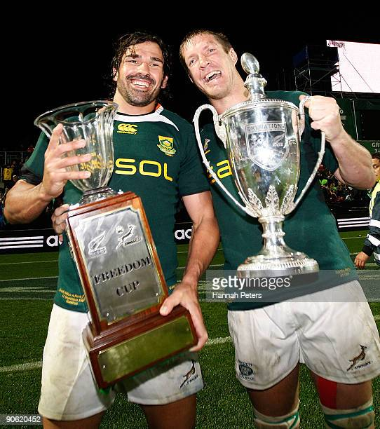 Victor Matfield and Bakkies Botha of South Africa celebrate with the Tri Nations and Freedom Cup after winning the Tri Nations Test Match between the...