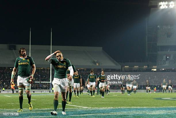 Victor Matfield and Bryan Habana of the Springboks walk from the field after the TriNations match between the New Zealand All Blacks and South Africa...