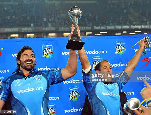 Victor Matfield and Fourie du Preez of the Bulls lifts the trophy after the Super 14 final match between Vodacom Bulls and Vodacom Stormers from...