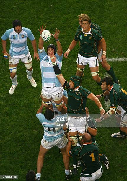 Victor Matfield of South Africa battles with Patricio Albacete of Argentina for the ball in a line out during the Rugby Word Cup Semi Final between...