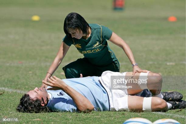 Victor Matfield speaks with Rene Naylor physiotherapist during the Springboks training session at Southport School on September 08 2009 on the Gold...