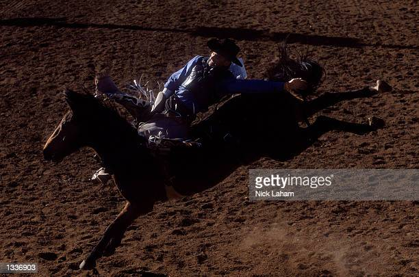 Victor McDowell rides in the Open Bareback section during the Mount Isa Rodeo held in Mount Isa Australia on August 11 2002 The rodeo event held in...