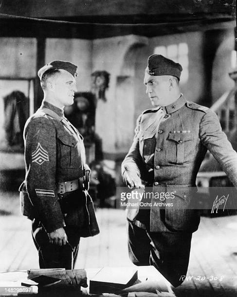 Victor McLaglen and Edmund Lowe talking to each other in a scene from the film 'What Price Glory' 1926
