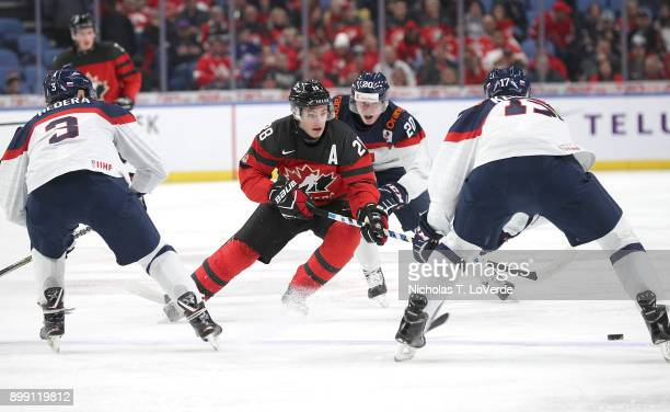 Victor Mete of Canada skates the puck up ice during the first period of play against Slovakia in the IIHF World Junior Championships at the KeyBank...