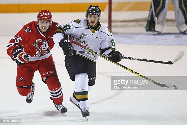 Victor Mete of the London Knights skates against Kyle Langdon of the Niagara IceDogs during Game Four of the OHL Championship final for the JRoss...