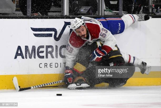 Victor Mete of the Montreal Canadiens and PierreEdouard Bellemare of the Vegas Golden Knights crash into the boards in the first period of their game...