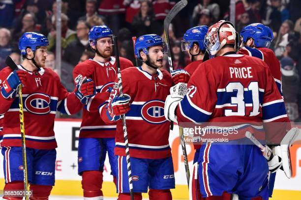 Victor Mete of the Montreal Canadiens celebrates a victory with goaltender Carey Price against the New York Rangers during the NHL game at the Bell...