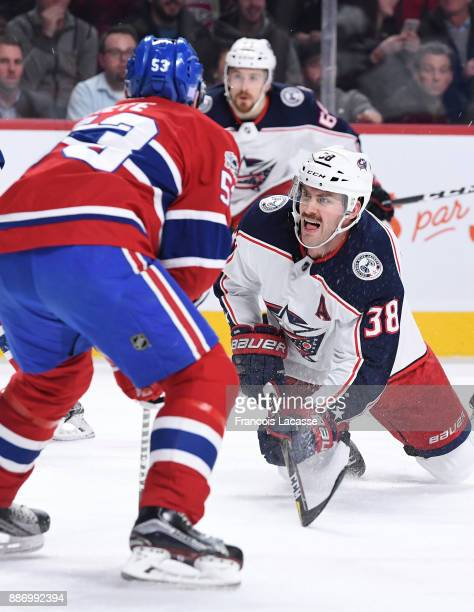 Victor Mete of the Montreal Canadiens skates against Boone Jenner of the Columbus Blue Jackets in the NHL game at the Bell Centre on November 27 2017...