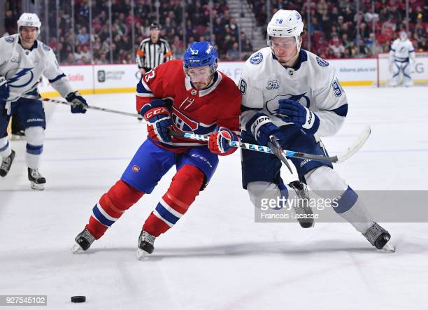Victor Mete of the Montreal Canadiens skates against Mikhail Sergachev of the Tampa Bay Lightning in the NHL game at the Bell Centre on February 24...