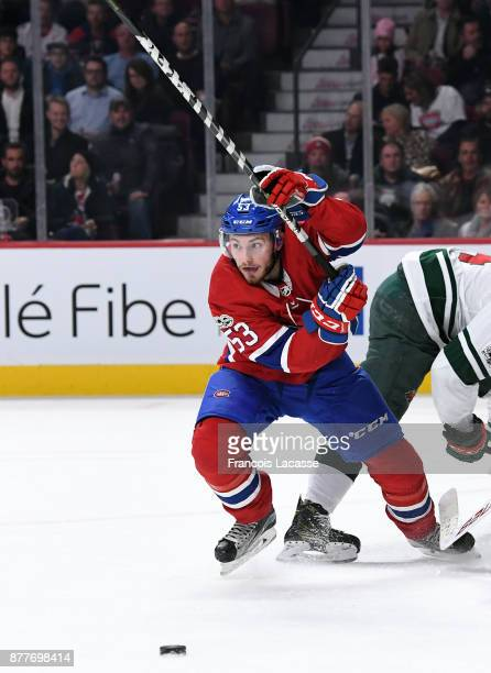 Victor Mete of the Montreal Canadiens skates for the puck against the Minnesota Wild in the NHL game at the Bell Centre on November 9 2017 in...