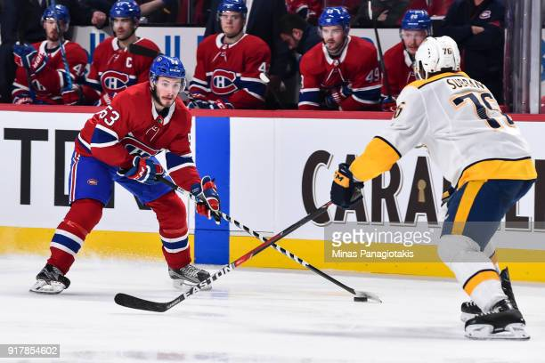 Victor Mete of the Montreal Canadiens skates the puck against PK Subban of the Nashville Predators during the NHL game at the Bell Centre on February...