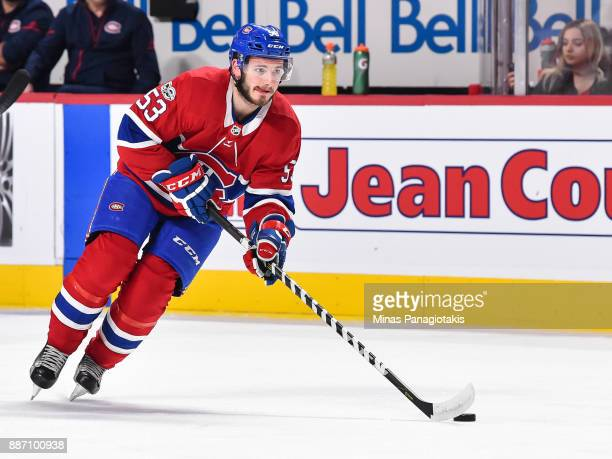Victor Mete of the Montreal Canadiens skates the puck against the Detroit Red Wings during the warmup prior to the NHL game at the Bell Centre on...
