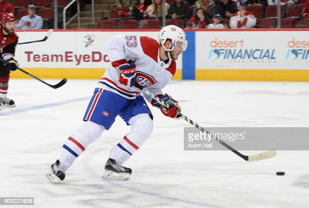 Victor Mete of the Montreal Canadiens skates with the puck against the Arizona Coyotes at Gila River Arena on February 15 2018 in Glendale Arizona