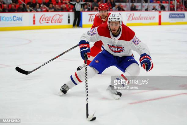 Victor Mete of the Montreal Canadiens turns up ice in front of Tomas Tatar of the Detroit Red Wings during the second period at Little Caesars Arena...