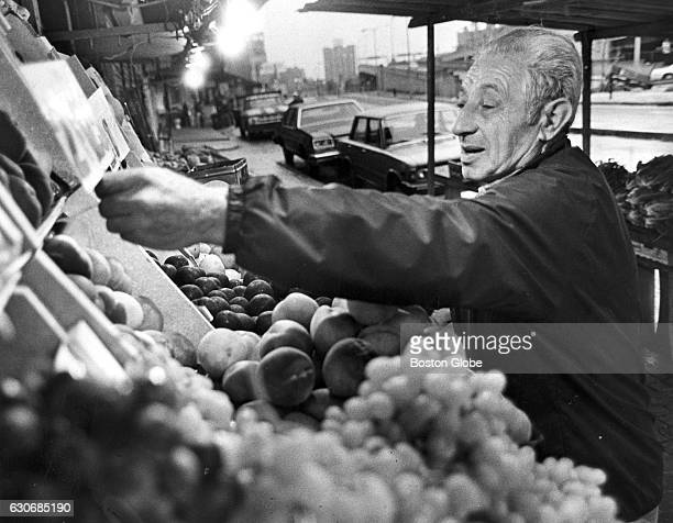 Victor Micarone of Charlestown Mass prepares his fruit stand in Boston's North End in the early morning of Sunday Aug 19 1979