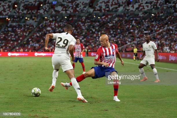 Victor Mollejo of Atletico Madrid challenges Antoine Bernede of Paris Saint Germain for the ball during the International Champions Cup match between...