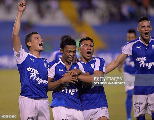 Victor Moncada Luis Alvarado and Carlos Sanchez of Honduras Progreso celebrate a goal against Pumas of Mexico during their CONCACAF Champions League...