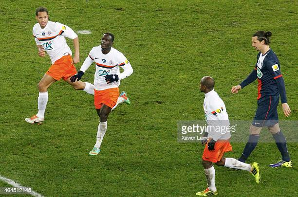 Victor Montano of Montpellier HSC celebrate the goal victory with Daniel Congre and Baye Niang Zlatan Ibrahimovic of Paris SaintGermain is...