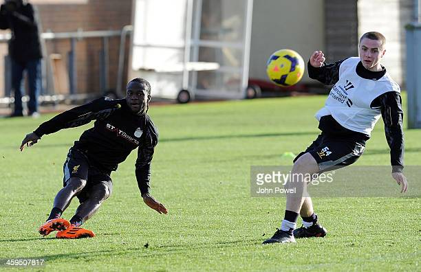 Victor Moses and Jordan Rossiter of Liverpool in action during a training session at Melwood Training Ground on December 27 2013 in Liverpool England