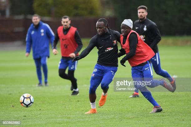 Victor Moses and N'Golo Kante of Chelsea during a training session at Chelsea Training Ground on March 16 2018 in Cobham United Kingdom