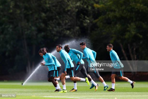 Victor Moses Davide Zappacosta Tiemoue Bakayoko Alvaro Morata and Eden Hazard of Chelsea run during a training session ahead of the UEFA Champions...