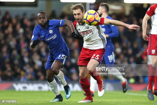 Victor Moses of Chelsea and Craig Dawson of West Brom chase down the ball during the Premier League match between Chelsea and West Bromwich Albion at...