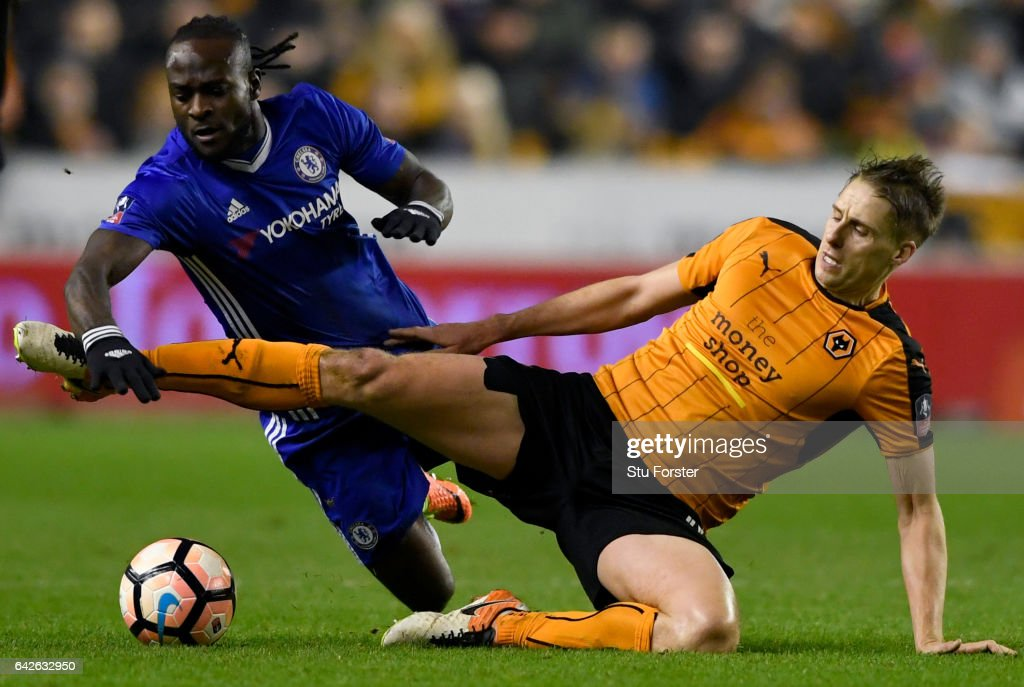 Victor Moses of Chelsea (L) and Dave Edwards of Wolves (R) battle for possession during The Emirates FA Cup Fifth Round match between Wolverhampton Wanderers and Chelsea at Molineux on February 18, 2017 in Wolverhampton, England.