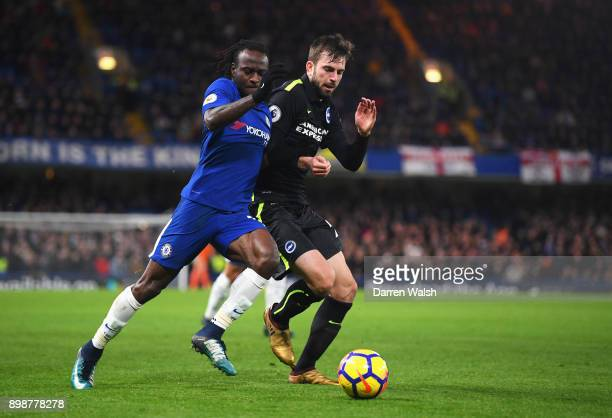 Victor Moses of Chelsea and Davy Propper of Brighton and Hove Albion battle for the ball during the Premier League match between Chelsea and Brighton...