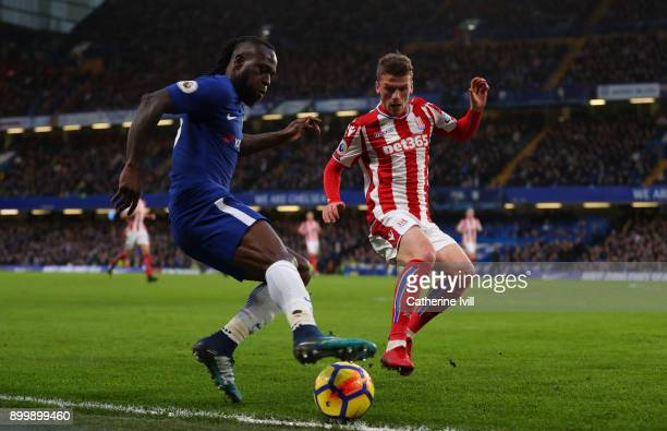 Victor Moses of Chelsea and Josh Tymon of Stoke City during the Premier League match between Chelsea and Stoke City at Stamford Bridge on December 30...