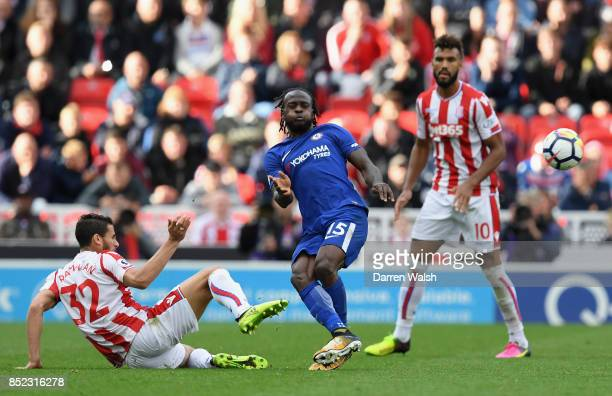 Victor Moses of Chelsea and Ramadan Sobhi of Stoke City compete for the ball during the Premier League match between Stoke City and Chelsea at Bet365...