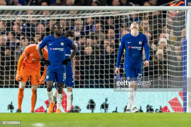 Victor Moses of Chelsea Andreas Christensen of Chelsea and Thibaut Courtois of Chelsea looks dejected during the UEFA Champions League Round of 16...