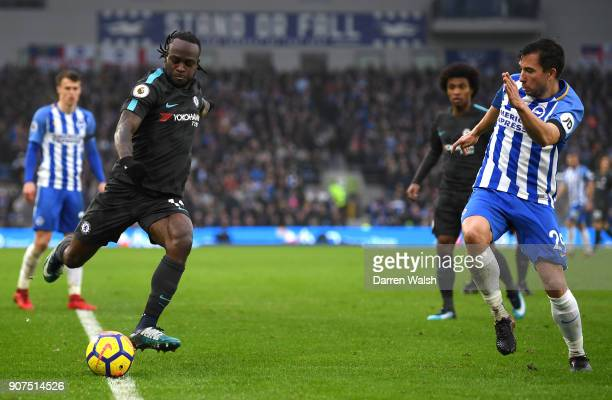 Victor Moses of Chelsea attempts to get past Markus Suttner of Brighton and Hove Albion during the Premier League match between Brighton and Hove...