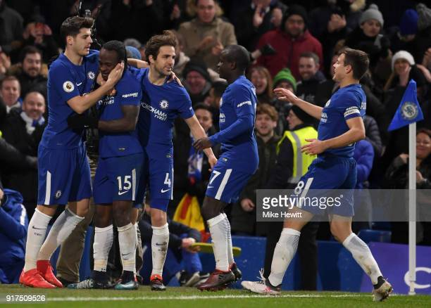 Victor Moses of Chelsea celebrates after scoring his sides second goal with his team mates during the Premier League match between Chelsea and West...