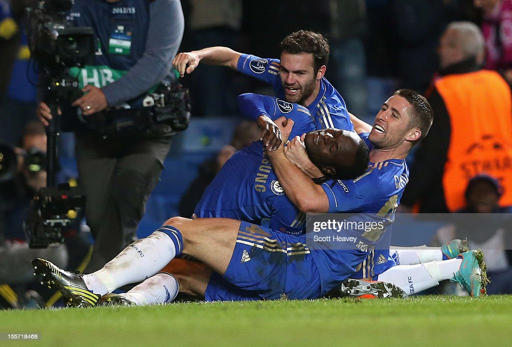 Victor Moses of Chelsea celebrates his goal with Juan Mata and Gary Cahill during the UEFA Champions League Group E match between Chelsea and Shakhtar Donetsk at Stamford Bridge on November 7, 2012 in London, England.