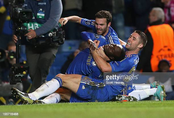 Victor Moses of Chelsea celebrates his goal with Juan Mata and Gary Cahill during the UEFA Champions League Group E match between Chelsea and...