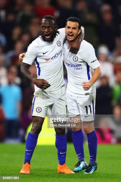 Victor Moses of Chelsea celebrates scoring his side's second goal with teammate Pedro during the Premier League match between Burnley and Chelsea at...