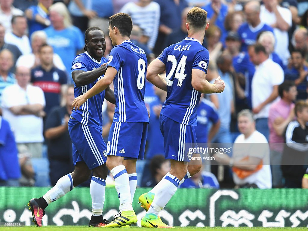 Victor Moses of Chelsea celebrates scoring his sides third goal with team mates during the Premier League match between Chelsea and Burnley at Stamford Bridge on August 27, 2016 in London, England.