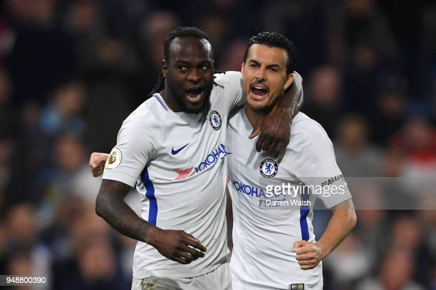 Victor Moses of Chelsea celebrates with teammate Pedro after scoring his sides second goal during the Premier League match between Burnley and...