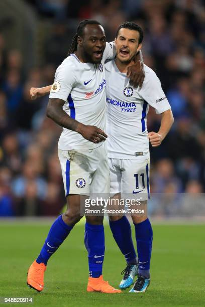Victor Moses of Chelsea celebrates with teammate Pedro of Chelsea after scoring their 2nd goal during the Premier League match between Burnley and...